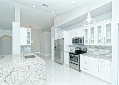 An example photo of an open, all white kitchen